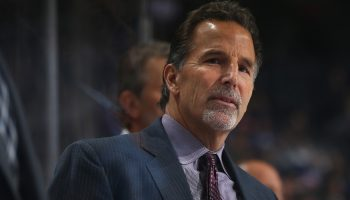 NEW YORK, NY - JANUARY 12: John Tortorella of the Columbus Blue Jackets looks on from the bench against the New York Islanders at the Barclays Center on January 12, 2016 in Brooklyn borough of New York City.  (Photo by Mike Stobe/NHLI via Getty Images)