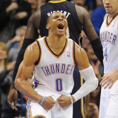 Oklahoma City Thunder point guard Russell Westbrook (0) reacts after making a basket and drawing a foul against the Indiana Pacers during the third quarter at Chesapeake Energy Arena. Mandatory Credit: Mark D. Smith-USA TODAY Sports