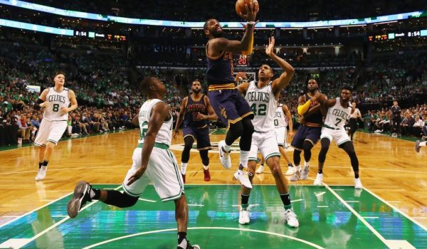 BOSTON, MA - MAY 25:  Kyrie Irving #2 of the Cleveland Cavaliers heads for the net as Terry Rozier #12 and Al Horford #42 of the Boston Celtics defend in the first half during Game Five of the 2017 NBA Eastern Conference Finals at TD Garden on May 25, 2017 in Boston, Massachusetts. NOTE TO USER: User expressly acknowledges and agrees that, by downloading and or using this photograph, User is consenting to the terms and conditions of the Getty Images License Agreement.  (Photo by Elsa/Getty Images)